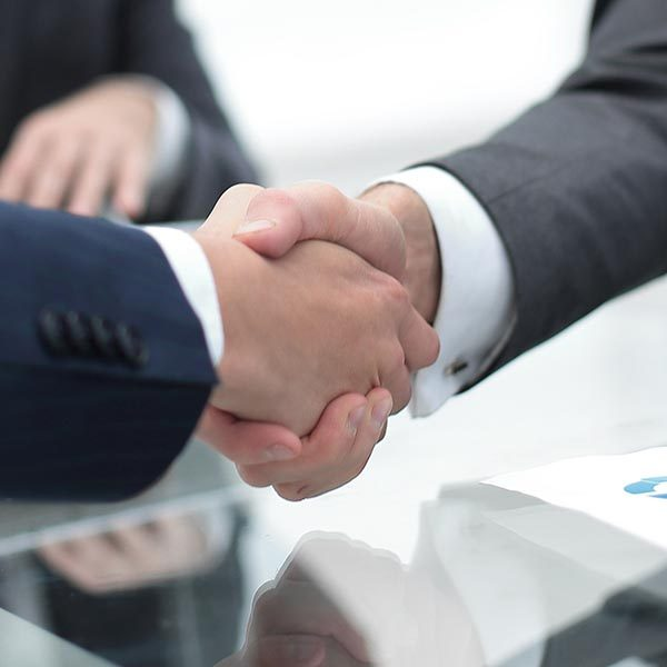 handshake business colleagues in office